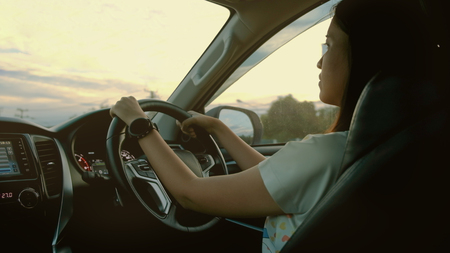 Woman drive a modern car on the road. Imagens