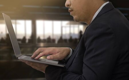 Close up man use mobile laptop in airport terminal