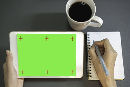 Close up business women working analyze business graph with green screen tablet