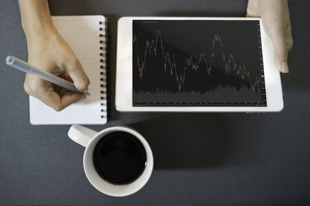 Close up business women working analyze business graph in tablet