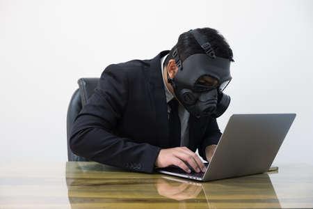Hacker man in suit and toxic mask Standard-Bild