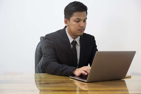 man serious working with laptop in office