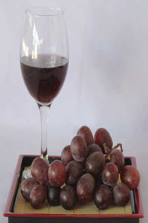 tabel: Red grape make beverages. Stock Photo
