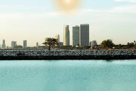 High-rise buildings in the city are located near the sea. The beauty of the design of a high rise building with the sea.