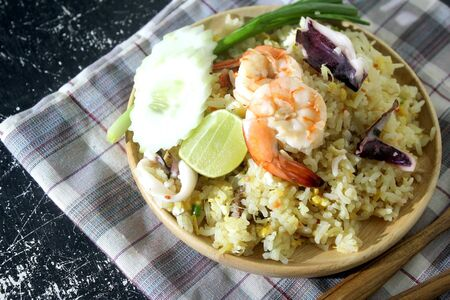 Seafood fried rice that is delicious, placed on the table for you when youre hungry. Banco de Imagens