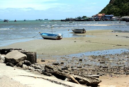 Two small boats are used for fishing.And this image is a view of the fisherman village that is next to the sea in Thailand. Banco de Imagens