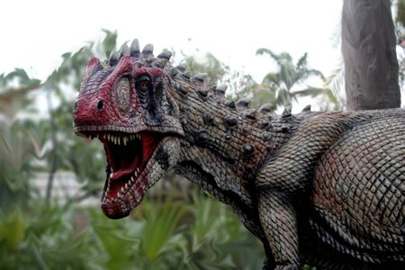 Carnivorous dinosaur statue.It has a fierce and scary look.