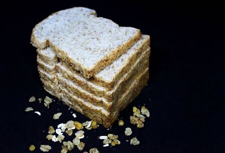Bread on a black background. Banco de Imagens