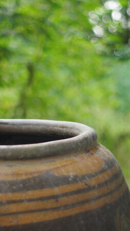 Old water jar for Outdoor shower in countryside of Thailand photo