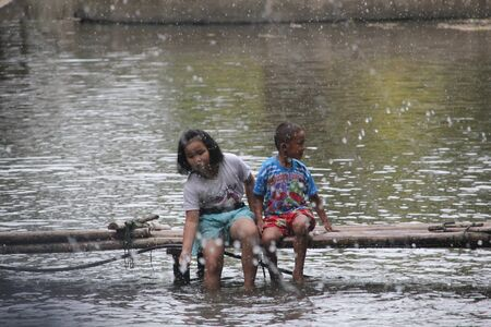 brethren: Chiang mai Province  Thailand  Apirl 19 2015.  People like taking the kids to play on the river in the summer. Editorial