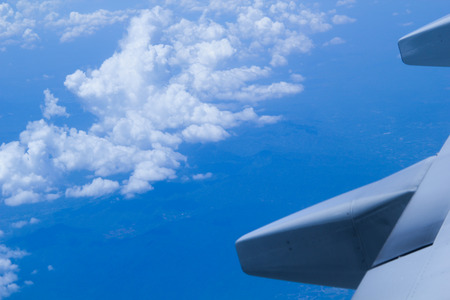 looking through window: Looking through window aircraft during flight in wing with a nice blue sky