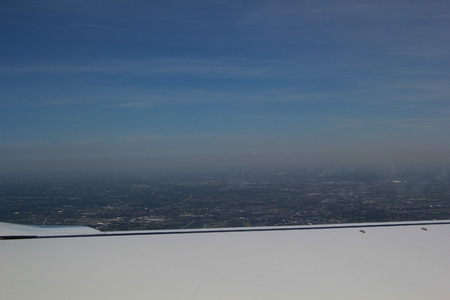 vertica: Looking through window aircraft during flight with a nice blue sky