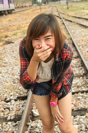 Cute girl walking on rails