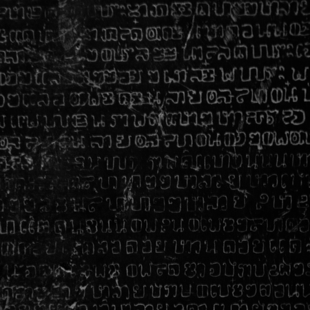 chiseled: Ancient Thai writing chiseled on stone