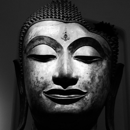 cambodia sculpture: a black and white image of buddhas head