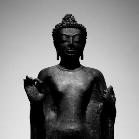 cambodia sculpture: a black and white image of buddha