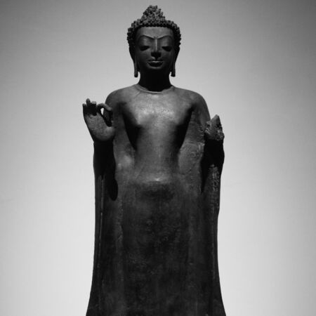 a black and white image of buddha