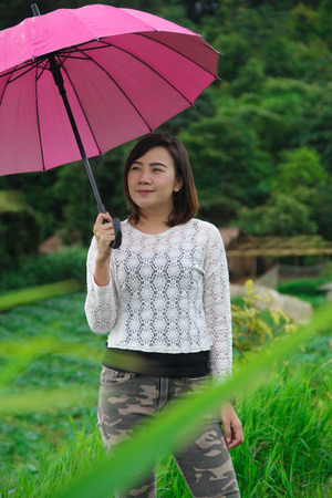 thai woman with an umbrella at Mon jam mountain, Maerim Chiangmai