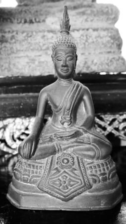 Black and White picture of Ancient Buddha Statue at Sukhothai historical park, Mahathat Temple ,Thailand. Stock Photo