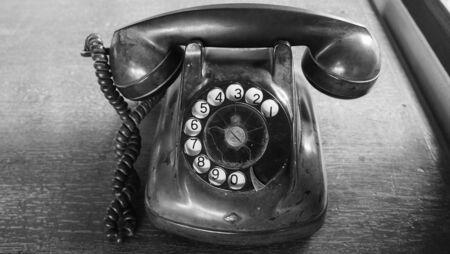 black and white picture of antique telephone. old telephone, vintage tone style
