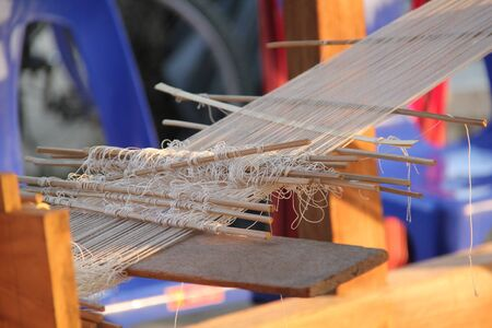 Weaving machine of Northern Thai native, used for weaving cotton for household use or for sale. Stock Photo