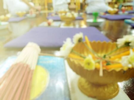 dhamma: The sacrificial offerings consist of flowers, incense and candles for worshiping monks, Buddhist rituals, blurred image background Stock Photo