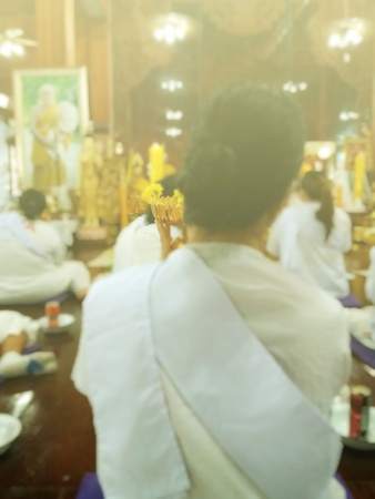 dhamma: Women are worshiping buddha statue on Dharma in temples. To purify the mind and prepare for the Dharma on the day of the Buddha, Activities on Buddhist Monks Day, blurred photo