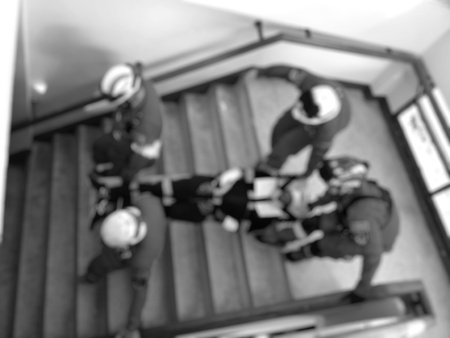 Search and rescue forces search injured person in fire, blur image, black and white tone Stock Photo