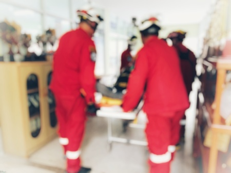 Search and rescue forces search injured person in fire, blur image Stock Photo