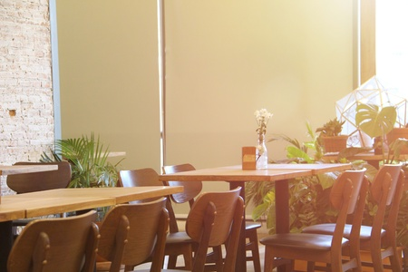 wood chairs and wood table in cafe, modern style Stock Photo