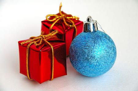 Lush christmas tree with colorful gift boxes two christmas gift boxes and a blue bulb photo negle Choice Image
