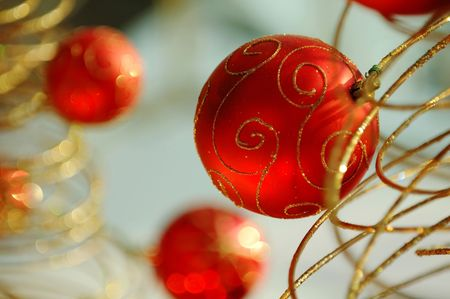 mirth: Some christmas balls decorated on a golden frame made tree