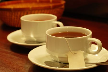 cups of tea: Two tea-cups and handmade basket Stock Photo