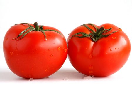 Two red, fresh, and juicy tomatoes Stock Photo