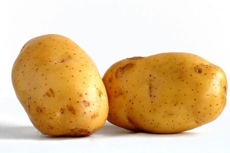Two ripen potatoes put together side by side Stock Photo - 711473