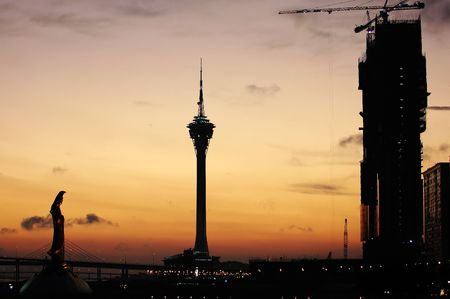 The sunset composition with Kun Iam statue, tower convention, and a under construction casion photo