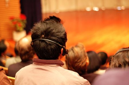 The audience wearing head phone for online translation