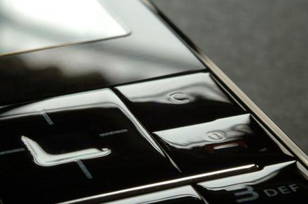 Close up shot of mobile keypad under dark environment photo