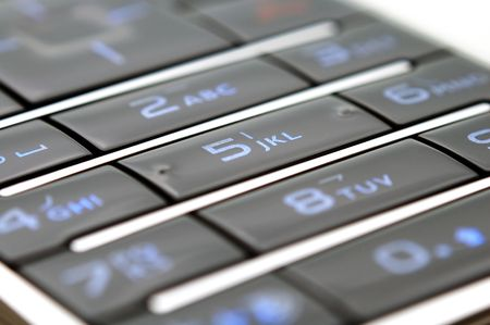 A close up shot of mobile keypad under light photo