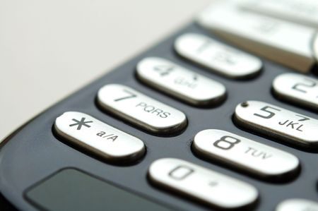 A close up shot of mobile keypad under light photo