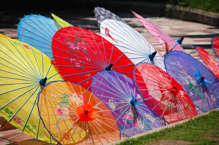 Shot of multi color traditional Chinese umbrellas photo