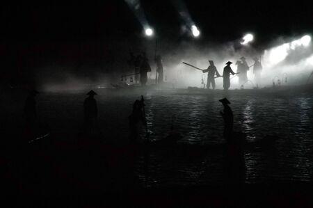 A group of fisherman fishing at night photo
