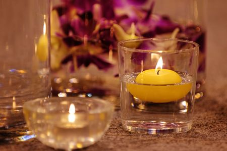 The close up shot of spa candles and flowers