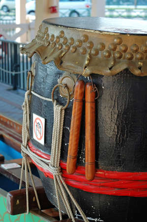 dragonboat: Detail of drum and drumsticks of dragonboat Stock Photo