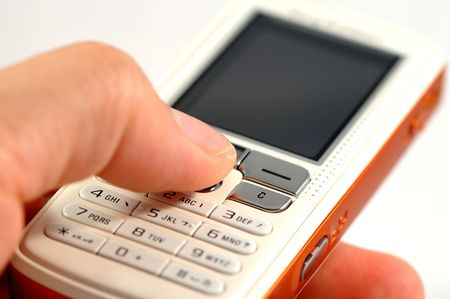 dialing: Dialing a modern mobile phone over white