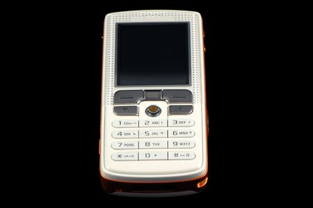 touchtone: Close up of modern mobile phone over black