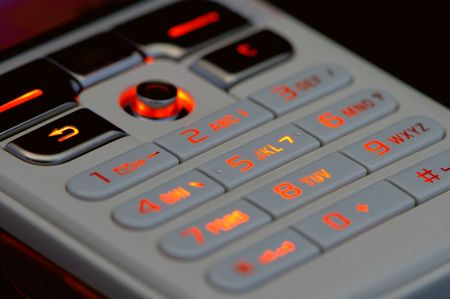 touchtone: Close up shot of mobile keypad with light under dark