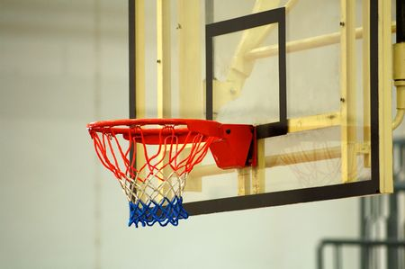 layup: A close up view of the backboard of basketball