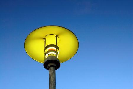 A close up of moderm street lamp over blue sky photo