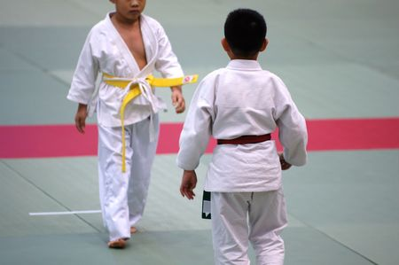 The karate kids fighting for the competition Stock Photo